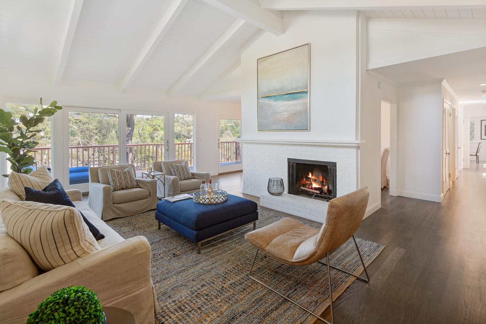 Soaring ceiling, fireplace, view